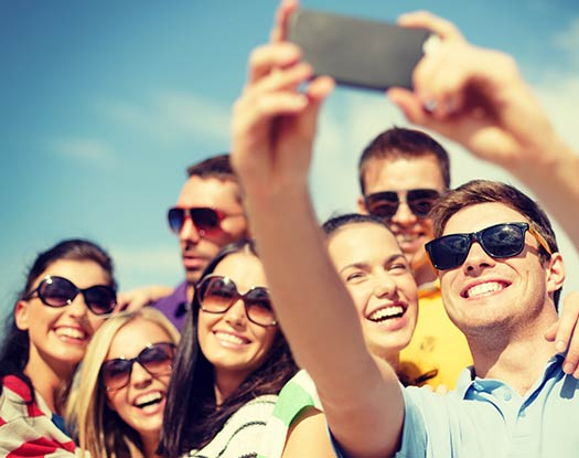 group of young adults taking a selfie